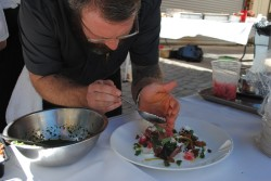 Executive Chef Paul Anders puts finishing touches on dish at Taste of Vail LAmb Cookoff 2013