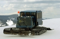 Many people arrive at the Mountaintop Picnic in a snowcat, courtesy of Vail Resorts.