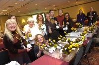 Seminars chairwoman Cary Hogan, fourth from left, and her crew get ready for another successful wine seminar.