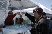 Guests enjoy cocktails at the igloo martini bar by Belvedere at the Mountain Top Picnic.
