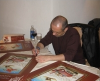 Signing posters is a pasttime for Taste of Vail's artist, Anton Arkhipov.