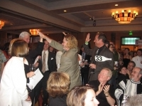 Auction participants celebrate their winning bid.
