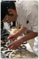 Doug Klacik of Game Creek Restaurant helps prepare the winning dish,